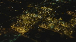 DCA07_163 - 4K stock footage aerial video of flying over an oil refinery, El Segundo, California, night
