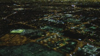 DCA07_167 - 4K stock footage aerial video of a passenger jet approaching LAX (Los Angeles International Airport), Los Angeles, California, night