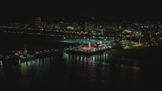 DCA07_172 - 4K stock footage aerial video of flying by the Santa Monica Pier, Santa Monica, California, night