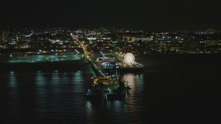DCA07_173 - 4K stock footage aerial video of passing by the Santa Monica Pier, Santa Monica, California, night