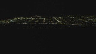 DCA07_176 - 4K stock footage aerial video tilt to reveal the San Fernando Valley, San Fernando Valley, California, night
