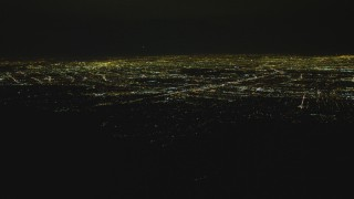 DCA07_177 - 4K stock footage aerial video pan across San Fernando Valley from off the coast, San Fernando Valley, California, night