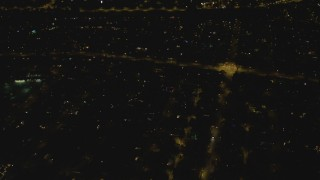 DCA07_180 - 4K stock footage aerial video of approaching an intersection, residential neighborhood, Woodland Hills, California, night