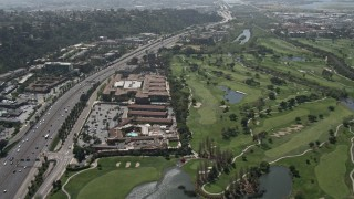 DCA08_004 - 4K stock footage aerial video pan across Interstate 8 to reveal golf course, Mission Valley, California