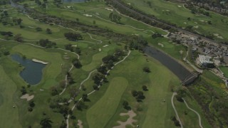 DCA08_005 - 4K stock footage aerial video fly over golf course, Mission Valley, California