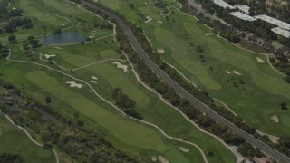 DCA08_006 - 4K stock footage aerial video of panning across and flying over a golf course in Mission Valley, California