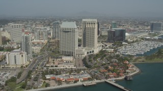 DCA08_013 - 4K stock footage aerial video orbiting a waterfront hotel, Downtown San Diego, California