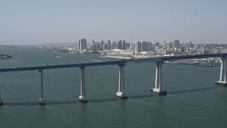 DCA08_017 - 4K stock footage aerial video of the Coronado Bridge, and Downtown San Diego in the background, California