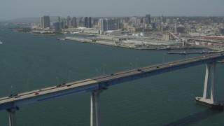 DCA08_022 - 4K stock footage aerial video orbit Coronado Bridge and reveal the skyline of Downtown San Diego, California