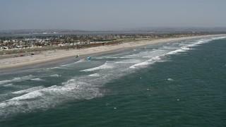 DCA08_028 - 4K stock footage aerial video orbit kite surfers near the beach, Coronado, California