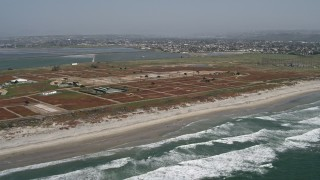 DCA08_031 - Aerial stock footage of 4K aerial \video of a beachside military base, Chula Vista, California