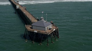DCA08_033 - 4K stock footage aerial video approach and orbit a pier in Imperial Beach, California
