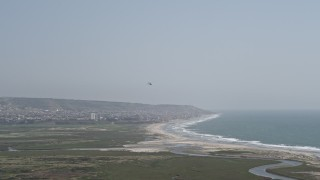 DCA08_034 - 4K stock footage aerial video of tracking a military helicopter over Imperial Beach, California
