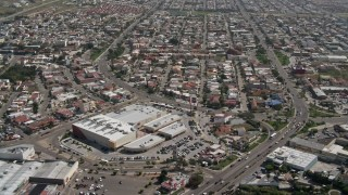 DCA08_042 - 4K stock footage aerial video of a shopping center and urban neighborhood, Tijuana, Mexico
