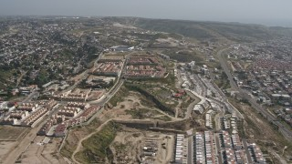 DCA08_043 - 4K stock footage aerial video of urban residential neighborhoods in hills in Tijuana, Mexico