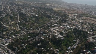 DCA08_044 - 4K stock footage aerial video flyby urban residential neighborhoods in Tijuana, Mexico