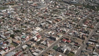 DCA08_045 - 4K stock footage aerial video of dense urban neighborhoods in Tijuana, Mexico