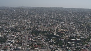 DCA08_048 - 4K stock footage aerial video of a view of urban residential neighborhoods in Tijuana, Mexico