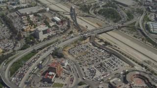 DCA08_050 - 4K stock footage aerial video orbit heavy traffic on the US/Mexico Border, Tijuana
