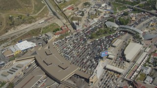 DCA08_052 - 4K stock footage aerial video orbit heavy border checkpoint traffic, US/Mexico Border, Tijuana
