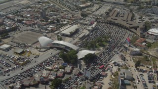 DCA08_054 - 4K stock footage aerial video of an orbit of heavy traffic on the US/Mexico Border, Tijuana