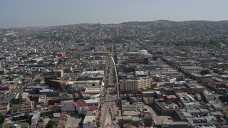 DCA08_060 - 4K stock footage aerial video of following a street to approach Tijuana Arch, Tijuana, Mexico