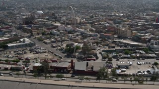 DCA08_061 - 4K stock footage aerial video of a reverse view of urban homes, reveal Tijuana Arch, Tijuana, Mexico