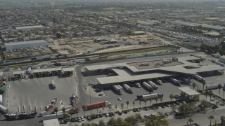 DCA08_088 - 4K stock footage aerial video of orbiting the border crossing on the US/Mexico Border in Otay Mesa, California