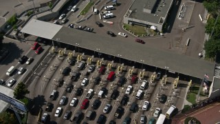 DCA08_090 - 4K stock footage aerial video approach the US/Mexico Border at Otay Mesa and tilt to a bird's eye of cars, California