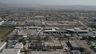 DCA08_093 - 4K stock footage aerial video of flying by the US/Mexico Border checkpoint in Otay Mesa, California