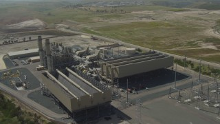 DCA08_100 - 4K stock footage aerial video circle around a power plant in Otay Mesa, California
