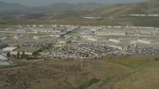 DCA08_103 - 4K stock footage aerial video of flying by an isolated prison in Otay Mesa, California