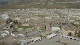 DCA08_104 - 4K stock footage aerial video of flying by a large prison complex, Otay Mesa, California