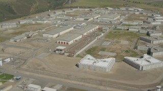 DCA08_105 - 4K stock footage aerial video orbit a prison complex in Otay Mesa, California
