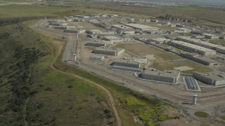 DCA08_106 - 4K stock footage aerial video of prison complex buildings, Otay Mesa, California