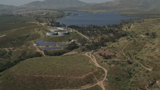DCA08_107 - 4K stock footage aerial video of a lakeside water treatment plant, Lower Otay Lake, California