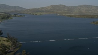 DCA08_108 - 4K stock footage aerial video fly over a water treatment plant to reveal Lower Otay Lake, California
