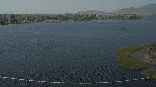 DCA08_111 - 4K stock footage aerial video of flying over a dam to reveal Lower Otay Lake, California