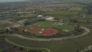 DCA08_112 - 4K stock footage aerial video approach Olympic training fields, Chula Vista, California