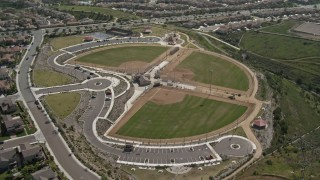 DCA08_120 - 4K stock footage aerial video tilt from tract homes to reveal baseball fields at sports park, Chula Vista, California