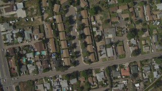 DCA08_128 - 4K stock footage aerial video of a bird's eye of tract homes, reveal mobile homes, Spring Valley, California