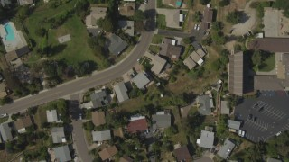 DCA08_131 - 4K stock footage aerial video of a bird's eye of a suburban neighborhood, reveal strip mall, La Mesa, California