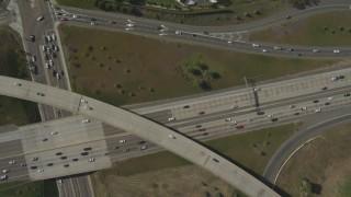 DCA08_132 - 4K stock footage aerial video of a bird's eye of a freeway interchange, reveal high school, La Mesa, California