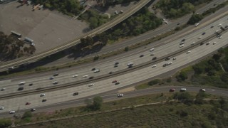 DCA08_135 - 4K stock footage aerial video of tracking light traffic on Interstate 8, Del Cerro, California