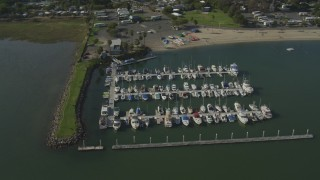 DCA08_145 - 4K stock footage aerial video of flying by a small marina in Fiesta Bay, Pacific Beach, California