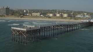 DCA08_147 - 4K stock footage aerial video of flying by beach to orbit Crystal Pier in Pacific Beach, California