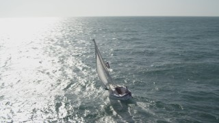 DCA08_157 - 4K stock footage aerial video orbit sailboat on its way out to sea, Mission Beach, California