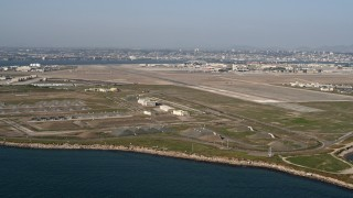 DCA08_170 - 4K stock footage aerial video of bunkers and runways on an island military base, Naval Air Station North Island, California