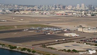 DCA08_172 - 4K stock footage aerial video of military jets and helicopters on an island base, Naval Air Station North Island, California