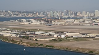 DCA08_173 - 4K stock footage aerial video of runways  and hangars on an island military base, Naval Air Station North Island, California